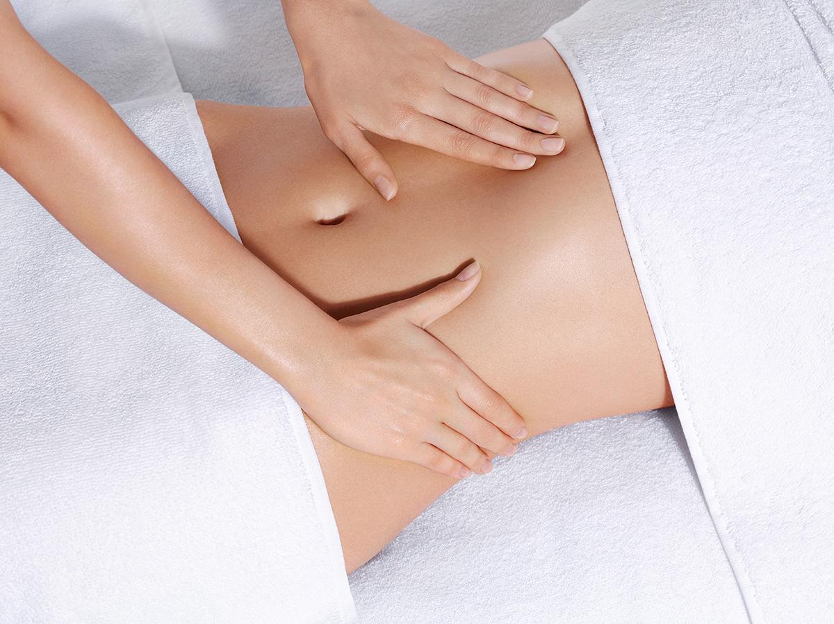 Barriga recebendo massagem